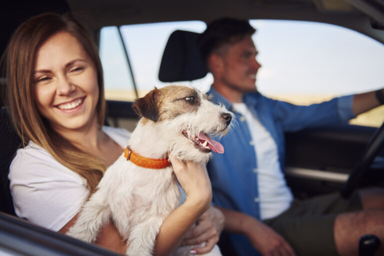 Happiness couple and their dog traveling together.